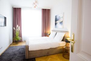 Una cama o camas en una habitación de The Flats Apartments - Naschmarkt