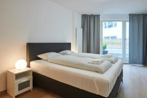 Cama ou camas em um quarto em Apartments Krakovska 13