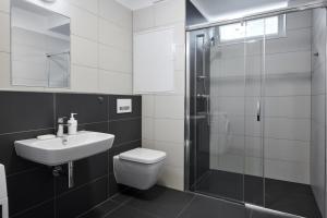 Um banheiro em Apartments Krakovska 13