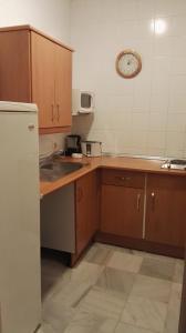Una cocina o kitchenette en Apartamentos Larga 70