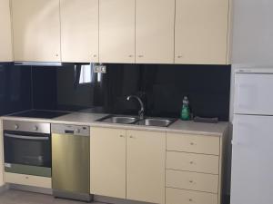 מטבח או מטבחון ב-Antonios Hotel Apartments