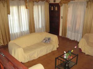 Una cama o camas en una habitación de Complejo Turístico Cerro de Oro