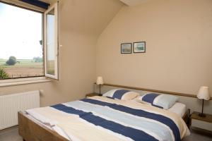 Cama ou camas em um quarto em Aen den Leewerk