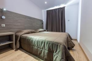 Cama ou camas em um quarto em Residence Club Marina Viva