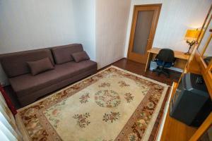 Uma área de estar em Standard Brusnika Apartments Krasnoselskaya