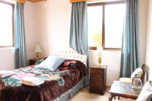 Giường trong phòng chung tại Pendalia Villa