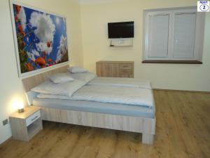 מיטה או מיטות בחדר ב-Sibiu-Heim-Apart