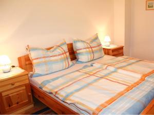 Una cama o camas en una habitación de Ferienwohnungen Brezjak