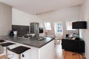 Una cocina o kitchenette en Cityden Centre Serviced Apartments