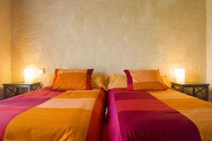 Cama ou camas em um quarto em Alcabala del Viento