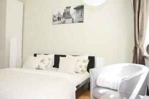 Cama ou camas em um quarto em True Gem