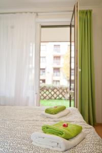 מיטה או מיטות בחדר ב-Semiramis Apartment