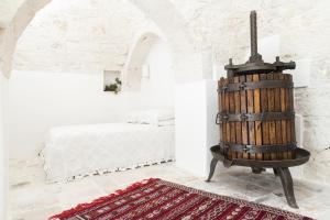 Giường trong phòng chung tại Trulleria Tagliente