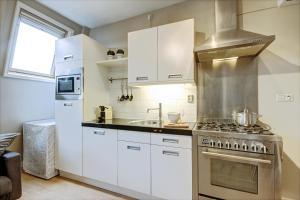 مطبخ أو مطبخ صغير في Gallery 4 Apartment
