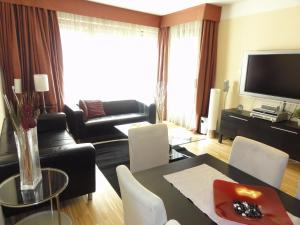 Uma área de estar em River Diamond Luxury Apartments