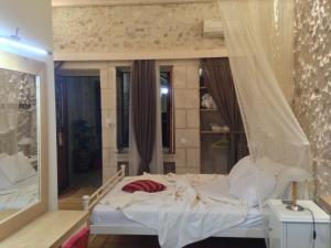 מיטה או מיטות בחדר ב-Barbara Studios
