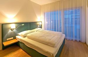 Cama ou camas em um quarto em Getreidemarkt 10 Apartments