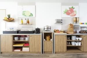 A cozinha ou cozinha compacta de Aparthotel Adagio Access Saint Louis Bâle