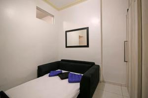 Cama ou camas em um quarto em Copa´s Apartment