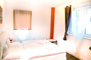 מיטה או מיטות בחדר ב-Grandmore Apartments Berlin Mitte