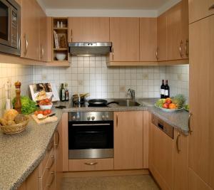 מטבח או מטבחון ב-Appartements Bergsonne