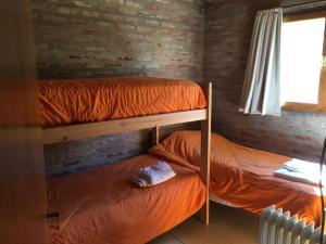 Una cama o camas cuchetas en una habitación  de El chalet de Alba