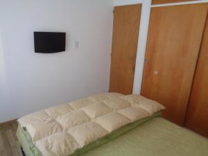 Cama ou camas em um quarto em Varadero II