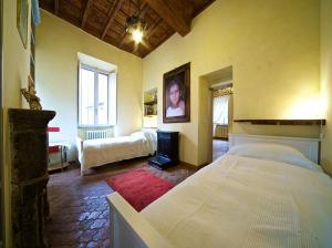 מיטה או מיטות בחדר ב-Charming Trastevere Apartment