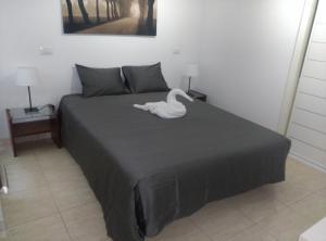 Una cama o camas en una habitación de Apartamento Anfora