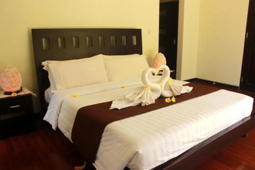 מיטה או מיטות בחדר ב-The Bali Bagus Villas