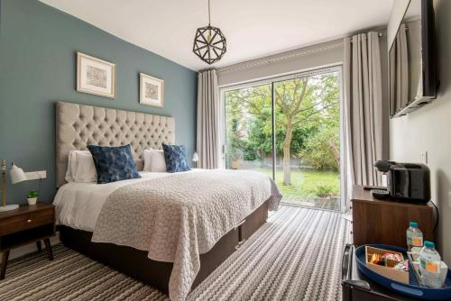 מיטה או מיטות בחדר ב-M-Hotels Apartments