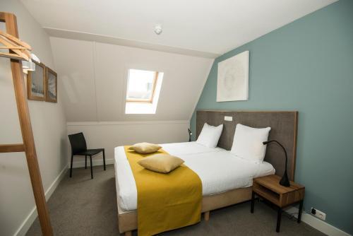 מיטה או מיטות בחדר ב-Vlierijck