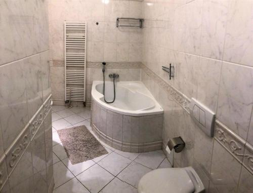 Um banheiro em Agnes - Residence Palladium