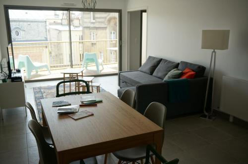 Khu vực ghế ngồi tại Appartement Forum Reims