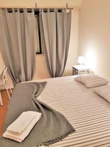 Cama ou camas em um quarto em Rooms by Boavista