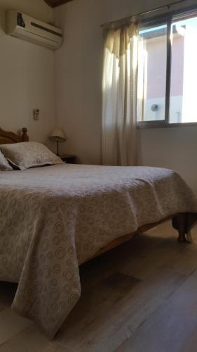 Cama ou camas em um quarto em Complejo Solar
