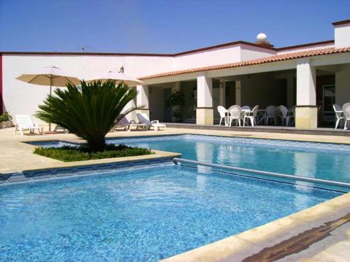Hoteles en san juan del r o con piscina for Piscinas de san juan