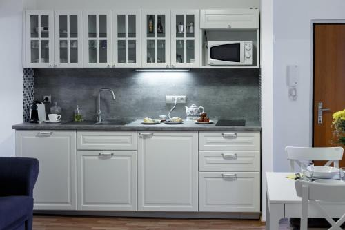 A cozinha ou cozinha compacta de Modern Romantic Apartment close to Castle
