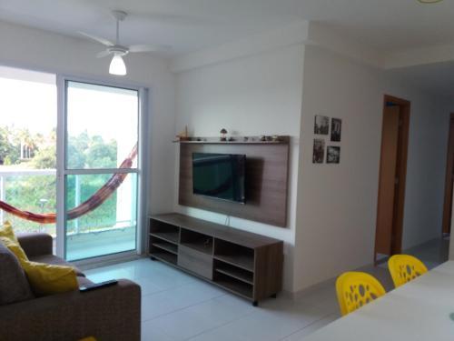 Uma TV ou centro de entretenimento em Palm Village Porto de Galinhas