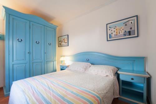 سرير أو أسرّة في غرفة في AG Casa Colombo