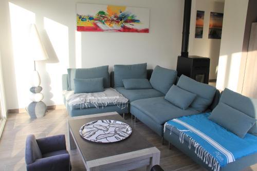 Khu vực ghế ngồi tại Gîte de vacance tout confort
