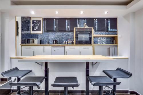 Una cocina o kitchenette en Suite Eliot