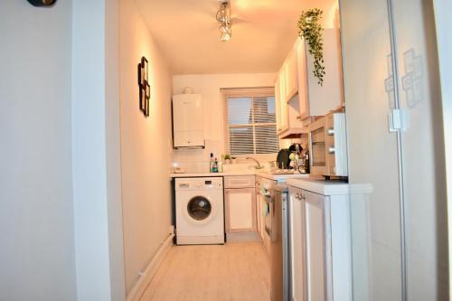 A cozinha ou cozinha compacta de 1 Bedroom Central Flat