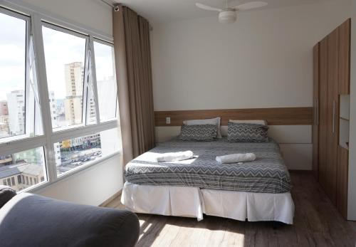 Cama ou camas em um quarto em Studio Metrô Luz em frente