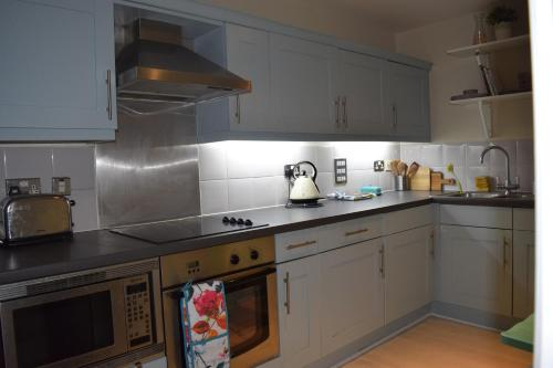 מטבח או מטבחון ב-Modern and Homely 2 Bed Flat in Whitechapel