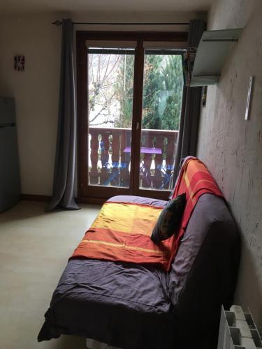 מיטה או מיטות בחדר ב-L'Appart D'Alice