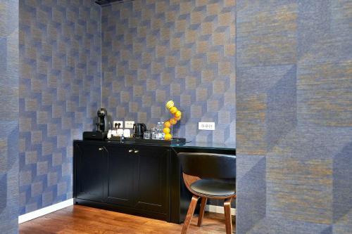 A cozinha ou cozinha compacta de H24 Apartment Inn