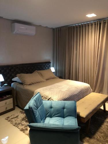 Cama ou camas em um quarto em Sky Studio São Paulo