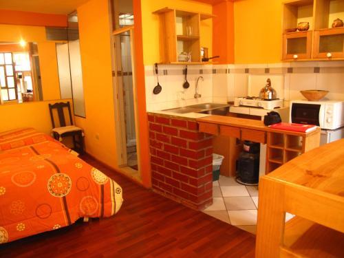 A cozinha ou cozinha compacta de Casa De Mama Cusco - The Treehouse