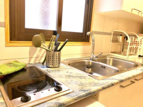 A cozinha ou cozinha compacta de City Apartment
